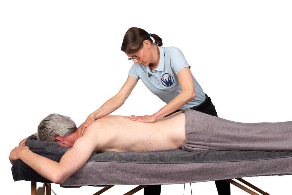 Massage van de rug bij pijnlijke spieren